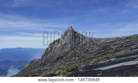 South Peak (3922m) of Mount Kinabalu Sabah Malaysia. Mount Kinabalu or Gunung Kinabalu is the 20th most prominent mountain in the world by topographic prominence.