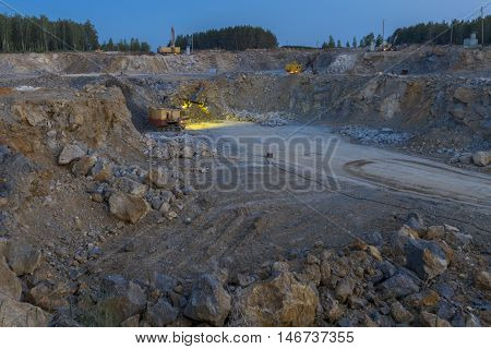 Idustrial background stone crusher in a quarry. mining industry night view