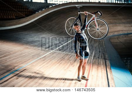 Young athlete with bicycle at velodrome