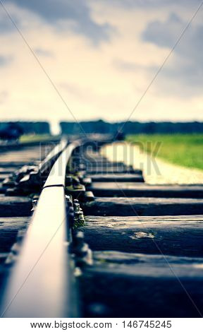 close up of an old rail with stormy clouds duo toned
