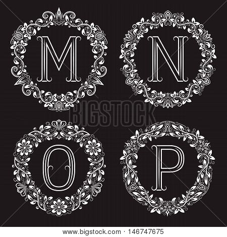 Set of vintage monograms in round wreath. M N O P white letters in floral frames.