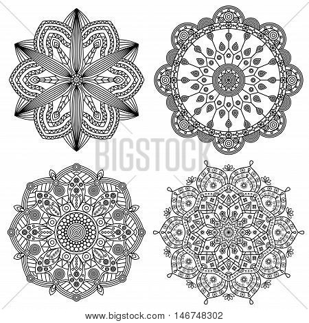 Collection of four mandala designs in black & white. Ornamental prints for coloring book pages, tattoo elements, stickers & mural art.