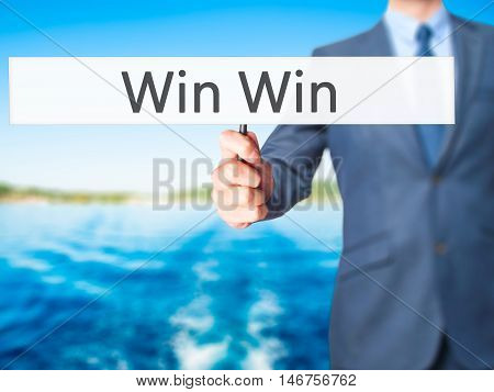 Win Win - Businessman Hand Holding Sign