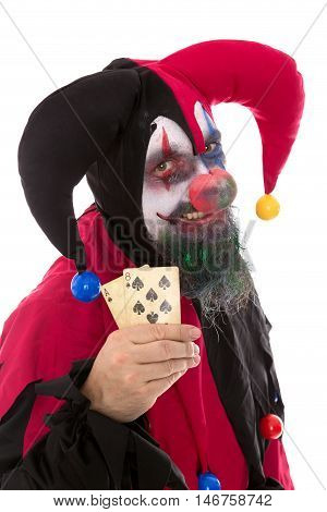 Madly Clown Holding Playing Cards, Isolated On White, Concept Gambling