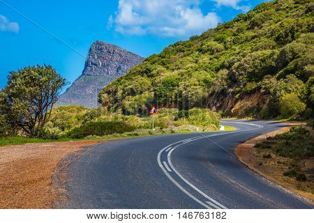 The scenic road on the famous Cape of Good Hope in the Atlantic. Travel to South Africa. The concept of active tourism and recreation