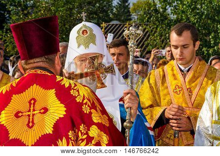 Perechin - Transcarpathia - Ukraine-11 September 2016: Patriarch of the Ukrainian Orthodox Church Kiev Patriarchate Filaret kisses Chrest before the consecration of a new wooden church.