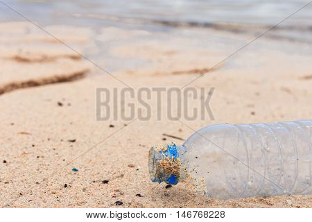 pastic bottle is garbage on the beach