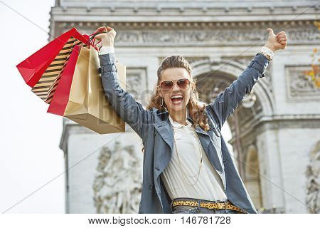 Smiling Fashion-monger In Paris Showing Thumbs Up And Rejoicing
