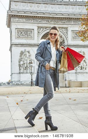 Happy Trendy Fashion-monger With Shopping Bags In Paris, France
