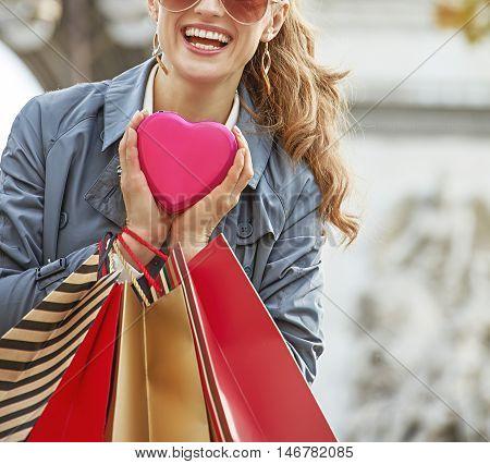 Woman With Shopping Bags Near Arc De Triomphe In Paris, France