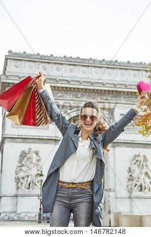 Woman With Shopping Bags Rejoicing Near Arc De Triomphe, Paris