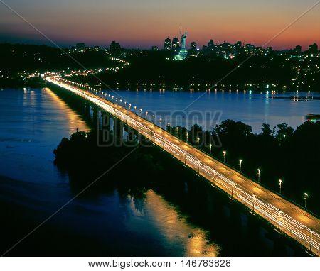 Illuminated Paton bridge and Mother Motherland monument in Kiev.