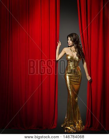 Actress Opening Red Cinema Curtain Woman in Elegant Gold Dress