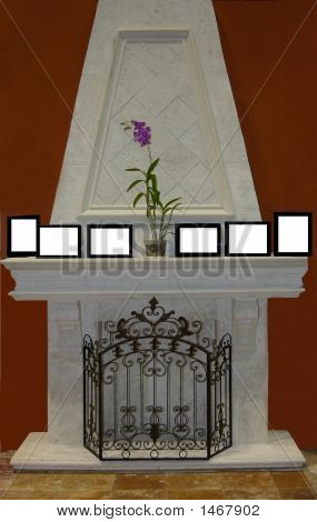 Faux Fireplace With Screen And Blank Frames On Mantle
