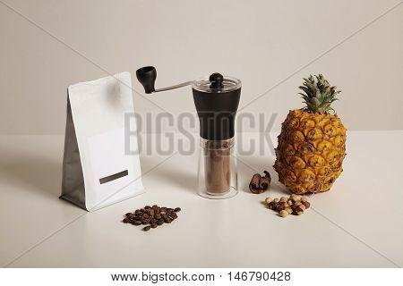 Coffee Beans, Grinder, Pineapple, Nuts And Cinnamon