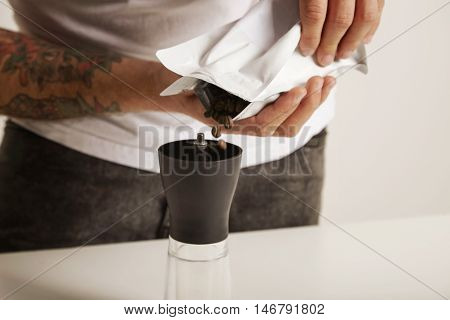 Pouring Coffee Beans Into Coffee Grinder