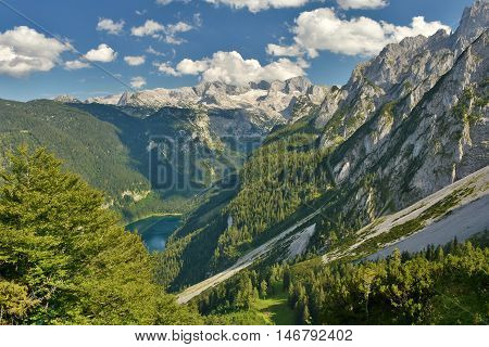 View from Gosaukamm cable car into Gosau valley with Gosau Lake and Dachstein mountain range