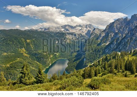 View from Zwieselalm into Gosau valley with Gosau Lake and Dachstein mountain range