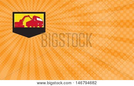 Business Card showing Illustration of a mechanical digger excavator earthmover loading a dump truck viewed from low angle set inside shield crest done in retro style.