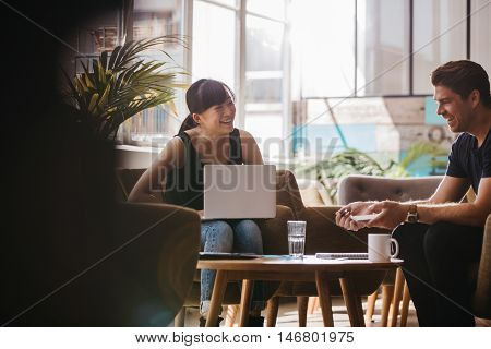 Business Partners Having A Meeting In Office Lobby