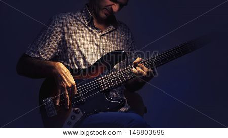 Bass player and his guitar expressions while playing.