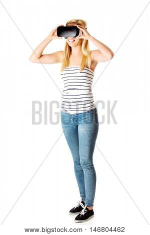 Girl wearing virtual reality goggles isolated on white.