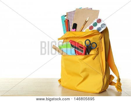 Yellow school backpack isolated on white