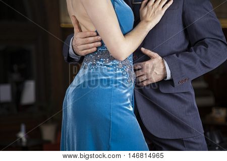 Midsection Of Tango Dancers Embracing In Cafe