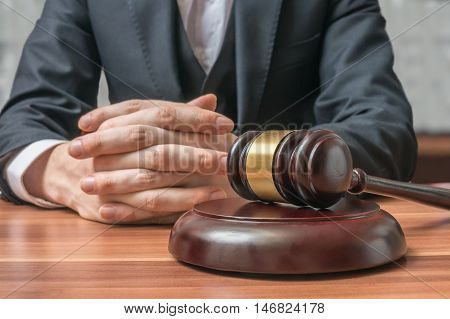 Justice And Law Concept. Lawyer Has Clasped Hands And Gavel In F