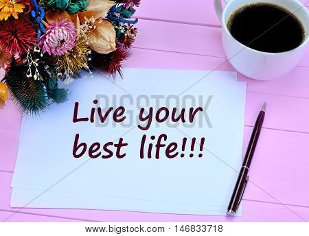 Live your best life. Motivational quote on paper