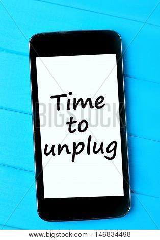 The words Time to unplug on smartphone display