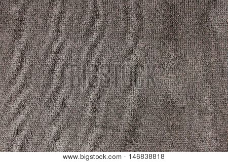 Natural wool knitted pattern burlap dark gray linen texture background