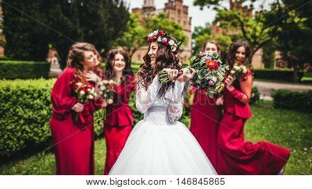 Bride With Bridesmaids In A Park