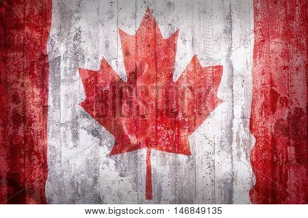 Grunge Style Of Canada Flag On A Brick Wall