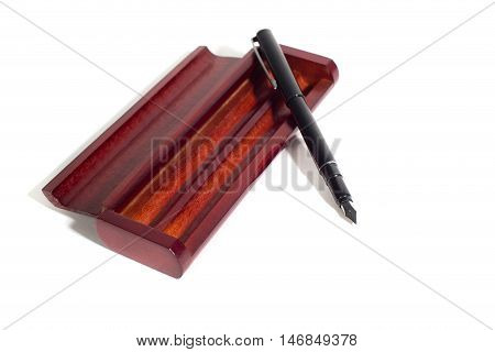 fountain pen in wooden case made of mahogany on the isolated background
