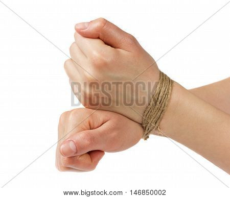 Woman hands bound by rope or string isolated on white background. Violence,  slavery and violation of rights concept.