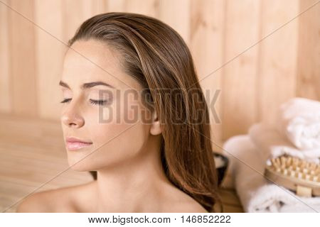 Woman In the Sauna with Body Products