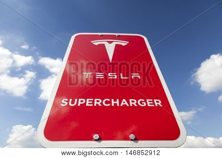 WILNSDORF GERMANY - SEP 1 2016: Tesla Supercharger station sign. The Supercharger is able to charge a battery from 10 to 80 percent in about 40 minutes