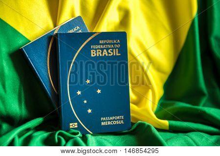 Brazilian Passport on Brazilian flag background