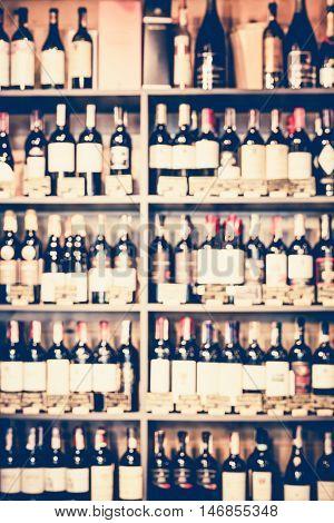 Blurred wine bottles on the store shelves
