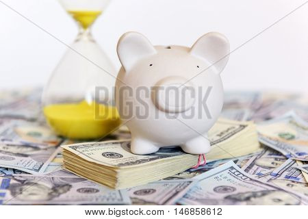 pig money box with sand-glasses and cash