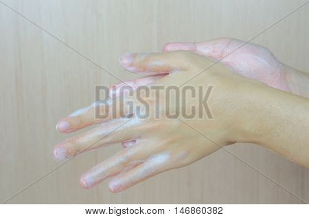 Woman washing her hands with foam soap