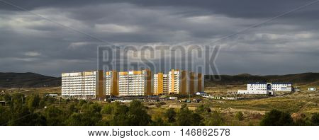 View of the newly built residential area, autumn, houses, housing complex, municipal housing, cheap accomodation, social housing, houses on the hills, central asia