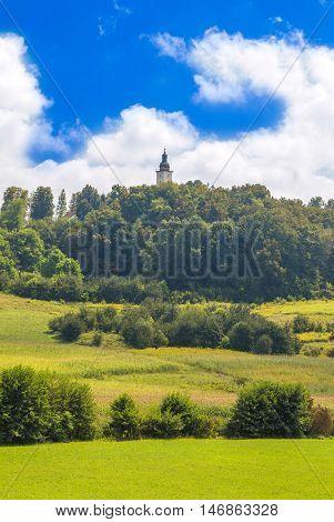 Green landscape in Zagorje, Croatia, church tower bell on hill