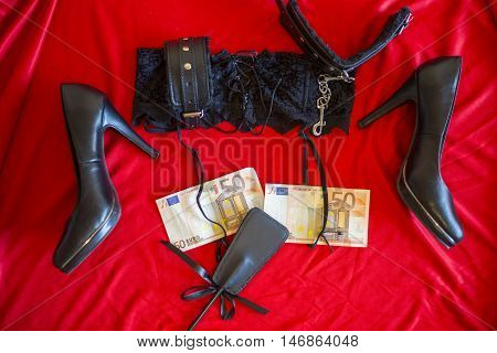 Prostitute Or Striptease Concept, 50 Euro Banknot With Sex Toys On Red Bed
