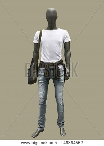Full length male mannequin dressed in shirt and blue jeans isolated on brown background. No brand names or copyright objects.