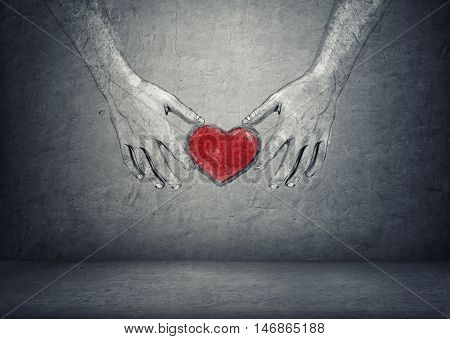 Hands of a man holding red heart on a concrete background. Ideas and concepts. Love and tenderness. Taking care. Solicitude and concern.