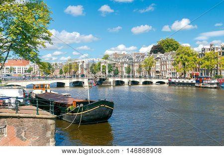 Adjustable skinny bridge over the Amstel River. Amsterdam. Netherlands.