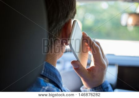 Man In Car Talking On Mobile Phone Whilst Driving