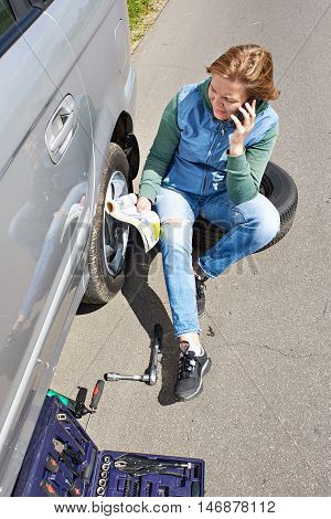 Woman With Phone Is Calling In Service And Reading Owner's Manual
